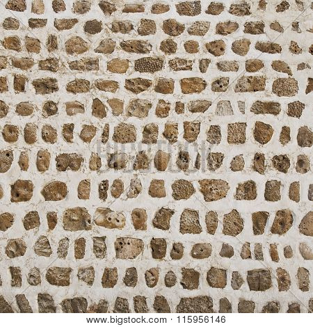 Close up of wall from an old architecture. Ancient arabic technique of building wall using coral stone and lime.