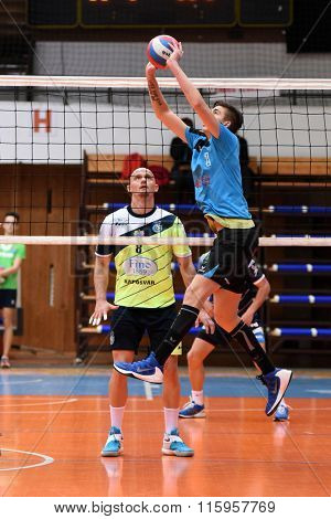 KAPOSVAR, HUNGARY - JANUARY 16: Peter Nagy (with ball) in action at a Hungarian National Championship volleyball game Kaposvar (green) vs. Sumeg (blue), January 16, 2016 in Kaposvar, Hungary.