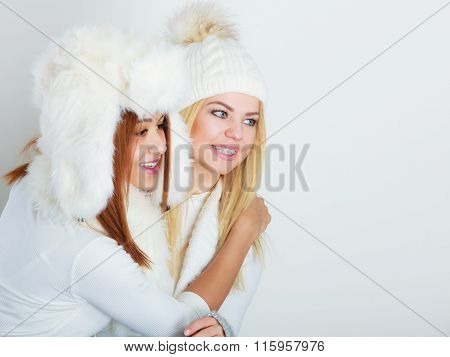 Two Girls In Winter Clothing Warm Cap