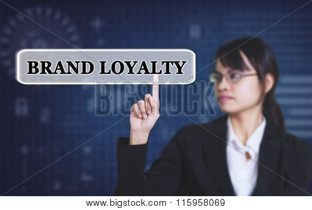 Businesswoman pressing message BRAND LOYALTY concept button.