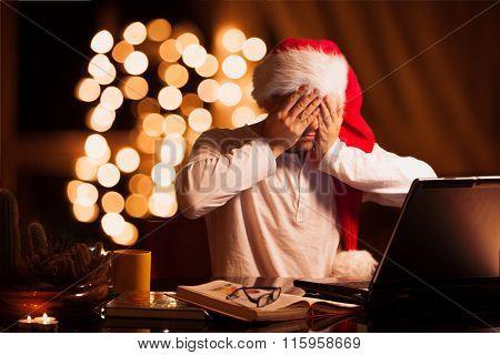 Man winks in cristmas hat