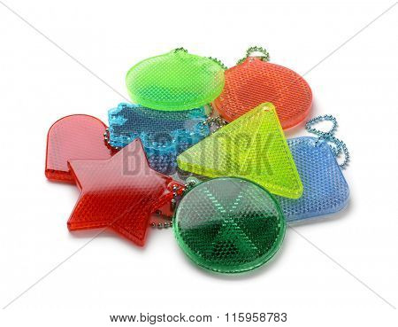 Pile of safety reflectors isolated on white