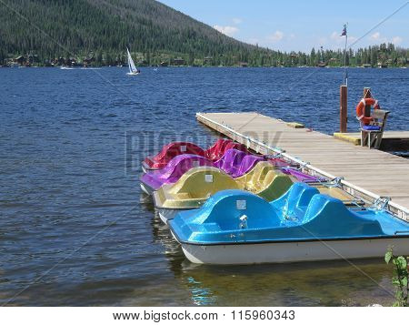 Colorful Paddle Boats Sitting At The Dock