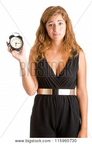 Woman looking surprise and holding an alarm clock isolated