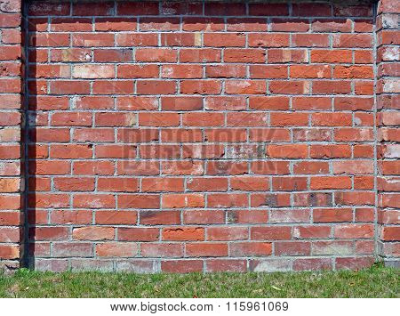 Red Brick Wall Background With Grass