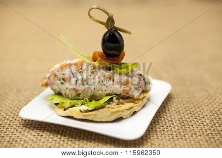 Fresh Spanish tapas on bread baguette smoked Norwegian salmon with black olive butter, herbs and onions. An excellent background for the menus, the restaurant, the Cafe Mediterranean cuisine