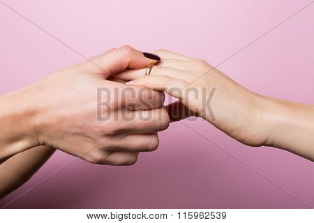 Women Partners Exchanging Rings In Engagement For St. Valentine
