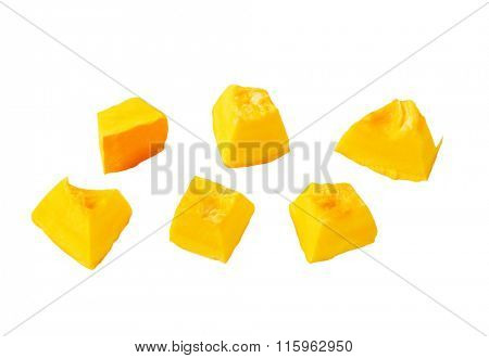 yellow pumpkin pieces isolated on white