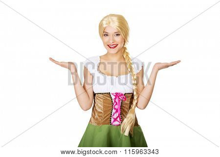 Woman wearing Bavarian dress with open hands.