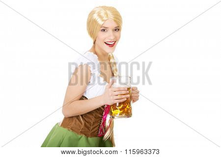 Beautiful bavarian woman with beer.
