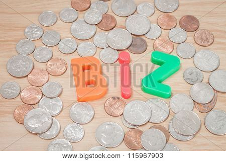 Biz Alphabet With Various Us Coins