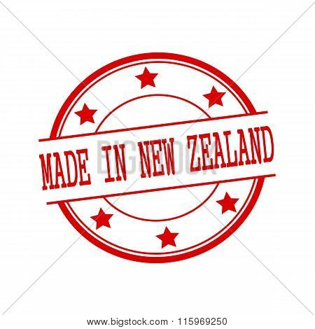 Made In New Zealand Red Stamp Text On Red Circle On A White Background And Star