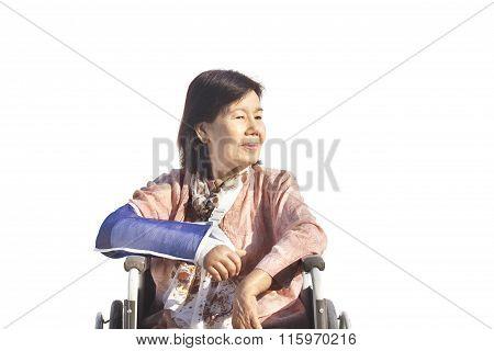 Asian Senior Woman With Broken Wrist On Wheel Chair