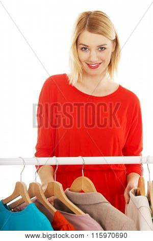 Woman deciding what to put on.