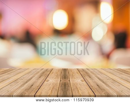 Wooden Board Empty Table blur in restaurant - can be used for display or montage your products.