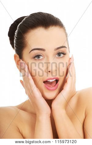 Shocked woman with make up.