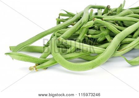 closeup of some raw green bean pods on a white background