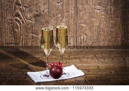 Two Beautiful Glasses Of Champagne Are Standing On A White Napkin On An Old Table