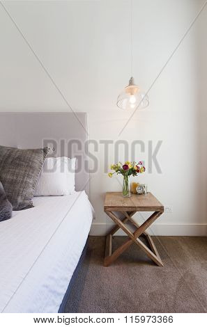 Hamptons Styled Bedside Table With Hanging Pendant Light In Luxury Home