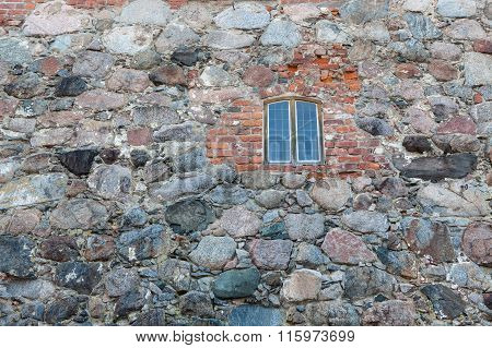 Glass window in old castle wall