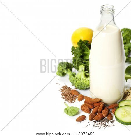 Ingredients of green smoothie over white - superfoods, vegan, vegetarian, healthy food, detox concept. Background layout with free text space.