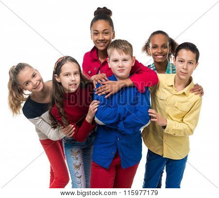 a group of children with different complexion embracing isolated on white background