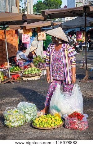 Vietnamese woman in conical hat at the market