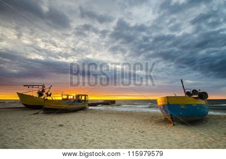 Sunset Over The Sea Beach,fishing boats on the coast of the Baltic Sea