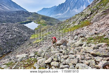 Hiking. Woman Climbs The Slope