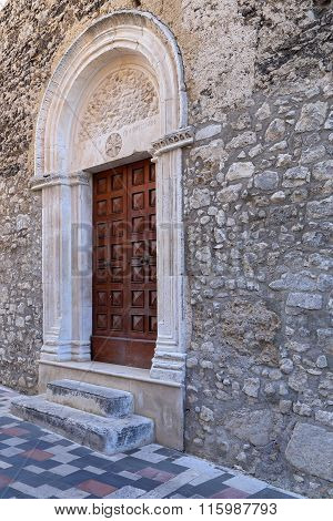 View door of a church in the ancient town - Corfinio L'Aquila in the region of Abruzzo - Italy