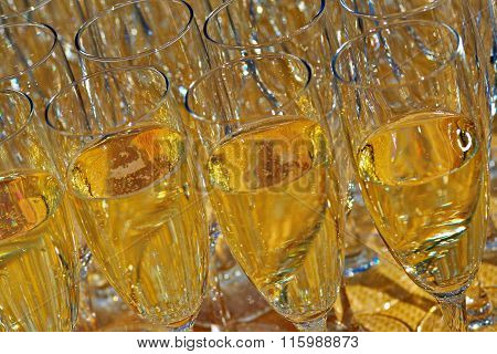 Many glasses of champagne, standing on the table