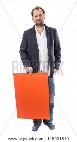 Man holding orange cardboard sheet.