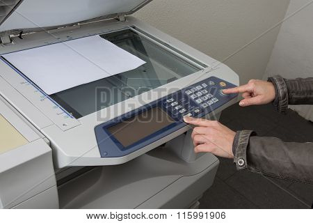 Office Life, Hand Pressing Start Button On Copy Machine