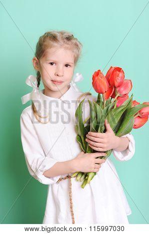 Kid girl holding tulips