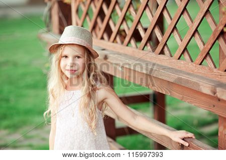 Smiling kid girl outdoors
