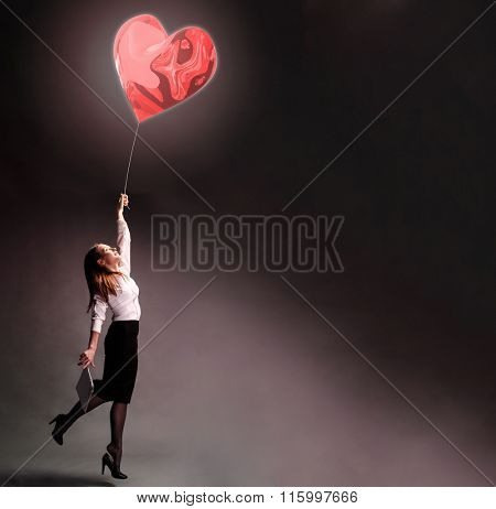 Business woman is flying away with love inspiration