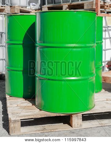 Green Barrels On Wooden Pallets