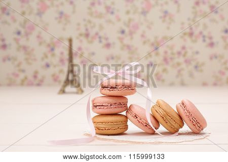 Macarons french dessert. Eiffel Tower on wood