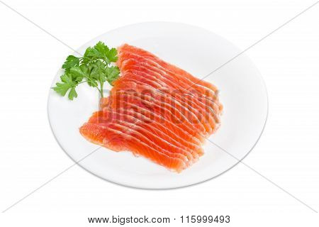 Sliced Fillet Of Salted Rainbow Trout On A White Dish
