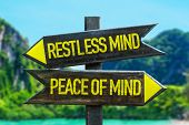 Restless Mind - Peace of Mind signpost in a beach background poster
