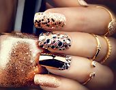 Постер, плакат: Golden Nail art manicure Holiday style bright Manicure with gems and sparkles Bottle of Nail Poli