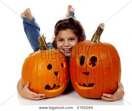 Smiling Between Pumpkins