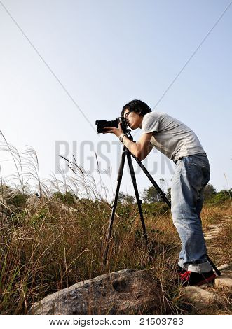 Photographer taking photo at wild