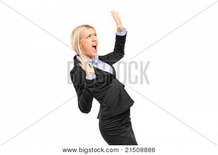 A scared young businesswoman shouting isolated on white background