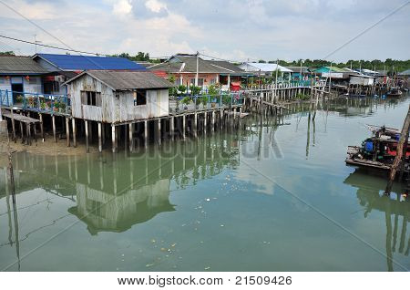 wooden houses build on the swamp land in the fishing village