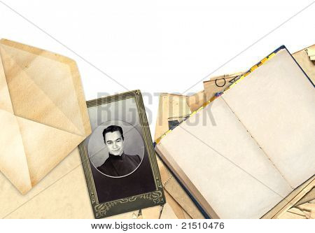 Frame with old book and photo. Objects isolated over white