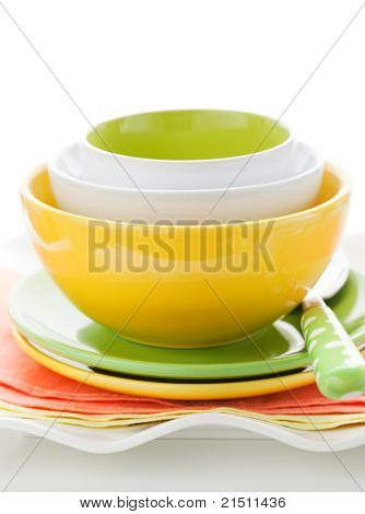 Arrangement of three colorful bowls and plates stacked up
