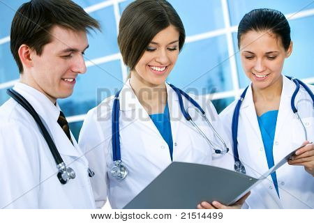 Young doctors confer outside the clinic