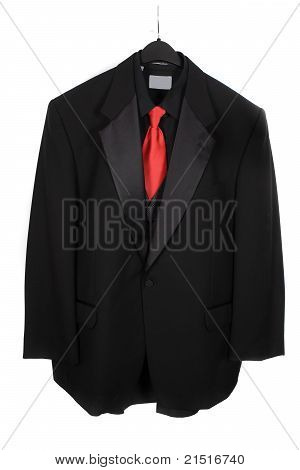Hanging Three Piece Suit With Red Tie