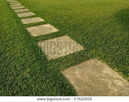 Direction of tile path through grass